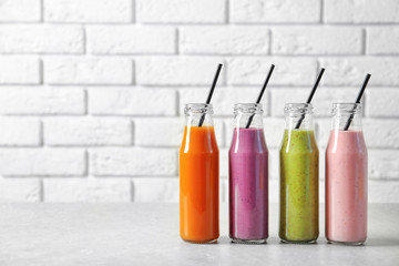 Bottles with yummy smoothie on table