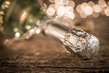 Champagne bottle and bokeg lights for holady concept