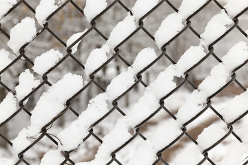 metal grating covered snow