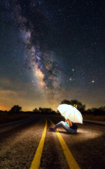 Woman on a road and milky way