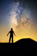 Milky way and human in silhouette