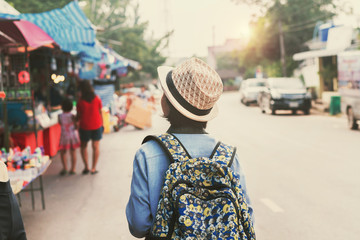 asian woman traveler shopping walking on street market
