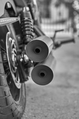 rear view of custom motorcycle, exhaust tips showing off; macro photograph of motorcycle and its parts