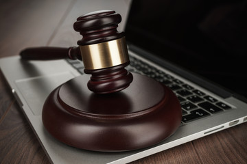 judge gavel on a laptop cyber crime concept