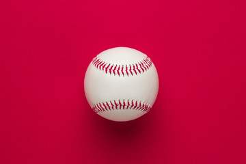 top view of baseball ball on red background