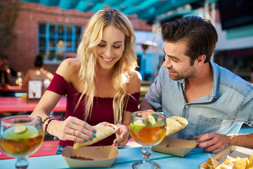 romantic couple eating street tacos at outdoor mexican restaurant Wall mural