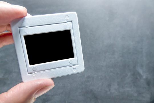 Holding film slide with chalkboard background