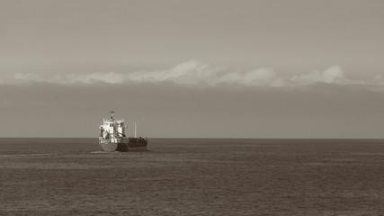 Seascape, ship on sea, horizon and sky.