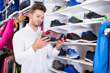 Man choosing new sneakers
