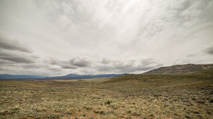 Empty field and power line near the Steens Mountain Range