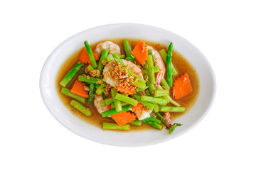 stir fried asparagus and carrot with shrimp on white plate isolated on white background with clipping path
