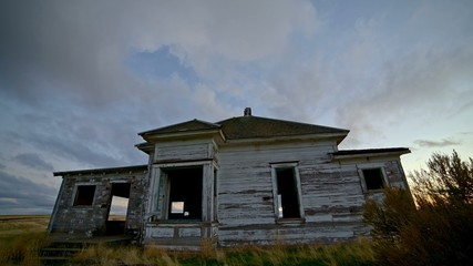 Old abandoned house farmhouse pioneers great depression settlers at sunset 2