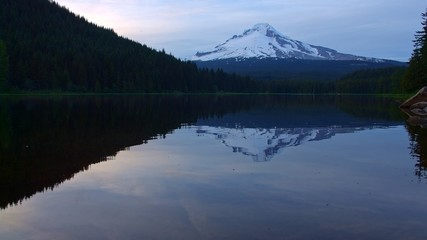 Reflection of mountain on forest lake Trillium Lake at Sunset with Mt. Hood Reflection Wide