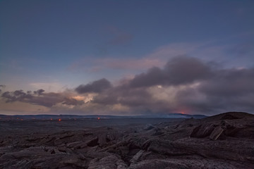Dawn over lava landscape and Puu Oo vent in distance
