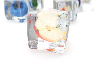 Apple in ice cube isolated on white with depth of field effects. Ice cubes with fresh berries. Berries fruits frozen in ice cubes, 3D rendering