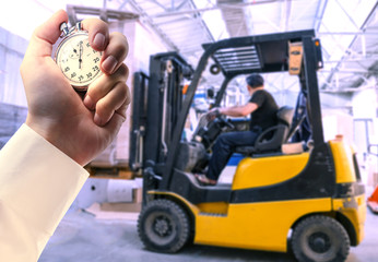 Paper products storehouse driver and stopwatch in hand