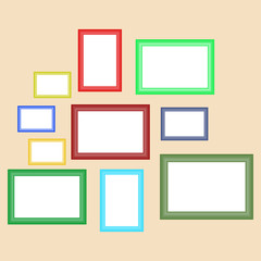 A set of retro frames for paintings of different colors hanging on the wall.