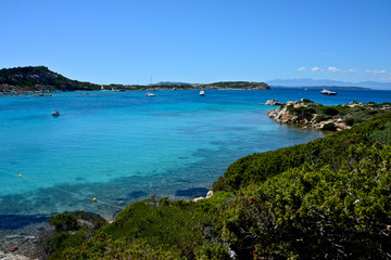 La Maddalena seascape with blue sea and yachts moored surrounded by nature