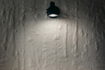 Abstract background. Brick wall, Lantern shines on a place for the text. copyspace