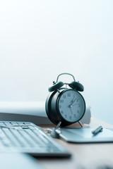Business project deadline, vintage clock on office desk