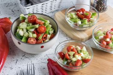 fresh spring vegetable salad with avocado pieces