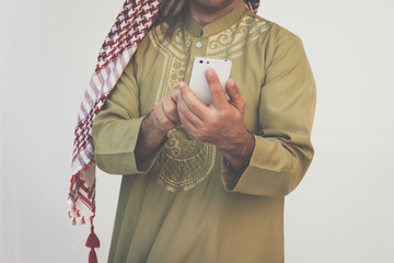 Arab businessman messaging on a mobile phone