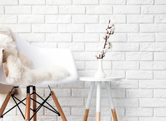 A part of modern minimalist interior with chair covered with white fur