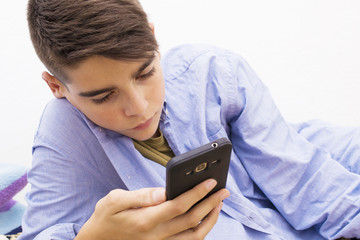 child with mobile phone at home