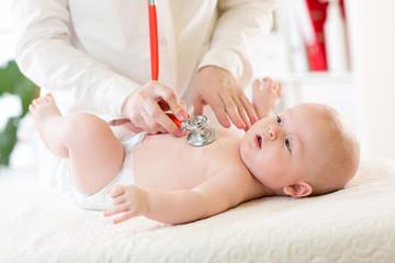 Professional pediatrician examining infant baby