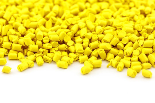 yellow plastic resin ( Masterbatch ) on white background