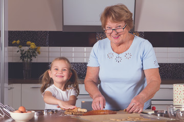 grandmother and granddaughter cook
