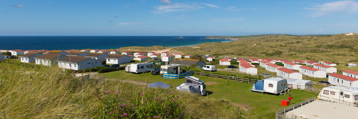 Wall Mural - St Ives Bay Cornwall with static caravans and camping in summer with beautiful blue sky panoramic view