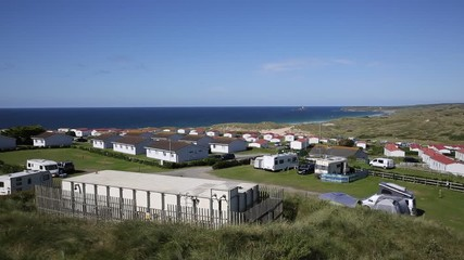 Fototapete - St Ives Bay Cornwall with static caravans and camping in summer with beautiful blue sky