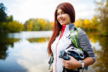 Picture of smiling woman with backpack and bicycle helmet