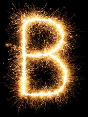 Sparkler firework light alphabet B isolated on black