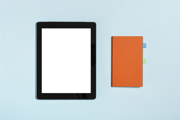 tablet pc with note on the blue background.