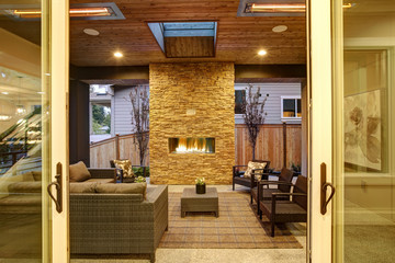 Dreamy outdoor covered patio with stone fireplace