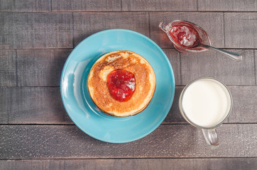 Small pancakes on a blue plate