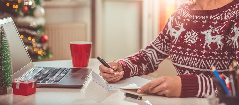 Women writing christmas letter