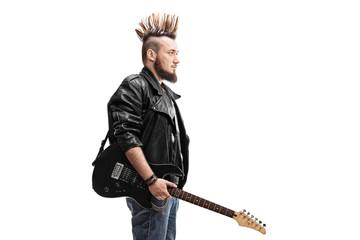 Punk rocker holding an electric guitar