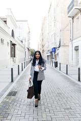 Elegant cheerful woman on street