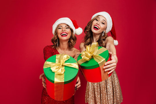 Portrait of two beautiful happy women in christmas hats