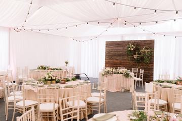 Wedding decorated restaurant in light colors and rustic style