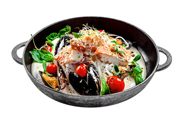 Gourmet Asian meal mad of seafood such as sea bass fish, mussels, crab meat and cockles with vegetables and rice noodles isolated on white.