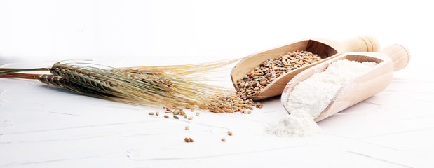 Whole grain wheat flour and seeds on white background. Wall mural