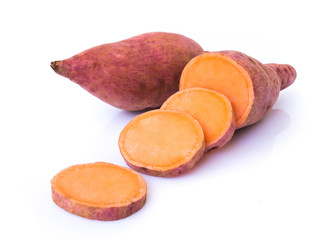 Sweet potato with slices on white background, raw food