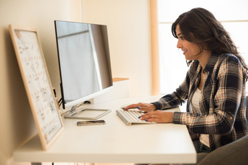 Woman programming computer
