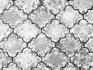 Detail of a textured wet stone sidewalk