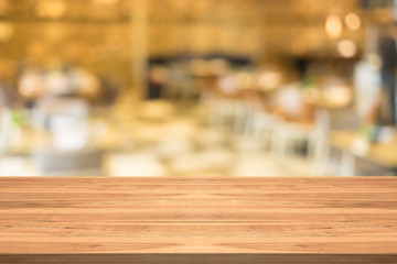 Empty wood table top on blurred background at coffee shop,copyspace for montage your products