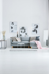 White lobby with fashion posters